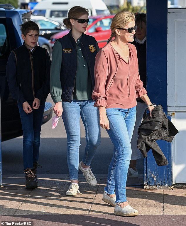 The mother-of-two beamed as she arrived at the litter pick alongside children Lady Louise Windsor, 16 James, Viscount Severn, 12,