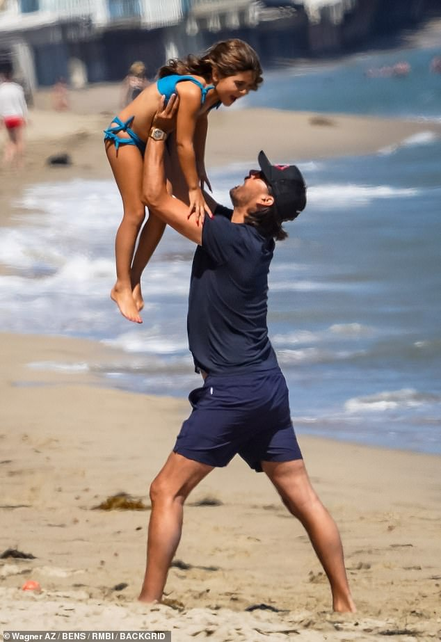All about his kids:Disick seen enjoying a day at the beach with daughter,Penelope, in Malibu; pictured in July