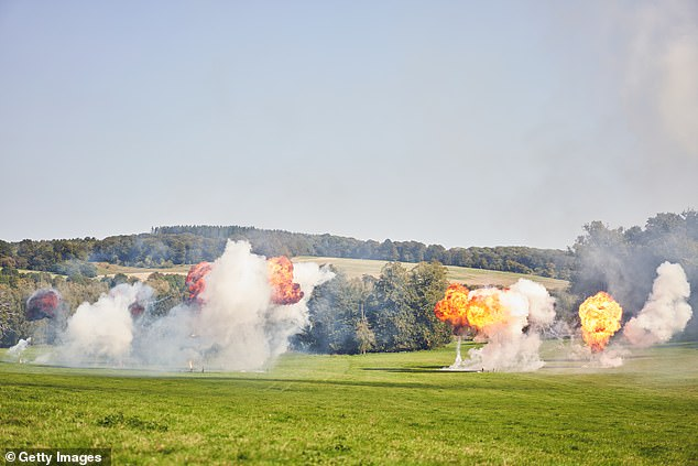 The impressive show saw firecrackers being set off and large explosions, with smoke billowing in the background as the models showcased the collection