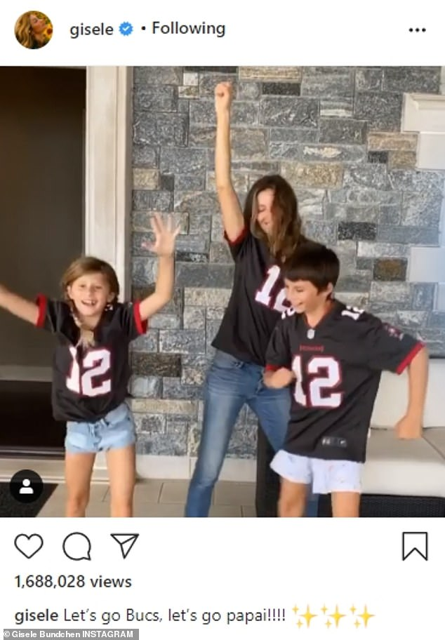 Team spirit: Last week, Gisele shared a boomerang to Instagram of herself and her children Benjamin, 10, and Vivian, seven, as they jumped up and down to cheer on Tom ahead of his