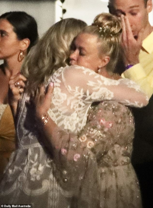 Support: Morgan (left) and her mother, Lisa Curry (right), were seen embracing each other at the conclusion of the heartbreaking funeral service