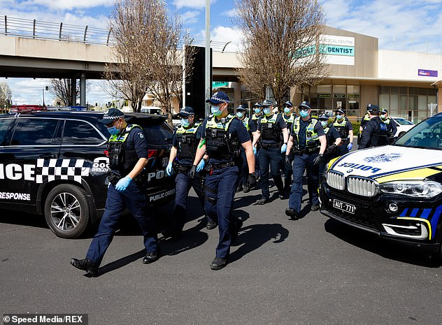 Large numbers of police arrive at Chadstone shopping center as they respond to a small group of protesters who have appeared in the supermarket