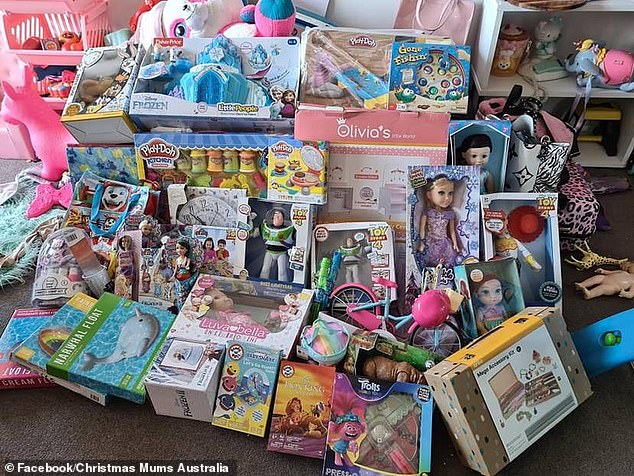 A super organised mother has been slammed for 'spoiling' her two-year-old daughter after she shared a picture on social media showing a mountain of Christmas presents
