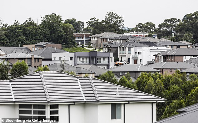 The forecast population decline, as a result of coronavirus measures, has also worried the Reserve Bank of Australia which last month released a paper which said a 40 per cent plunge in house prices was an 'extreme but plausible scenario'. Pictured are houses at Kellyville in Sydney's north-west