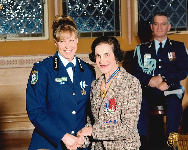 Wallace is pictured at NSW Government House after being presented with the Australian Police Medal by then Governor Marie Bashir in 2012