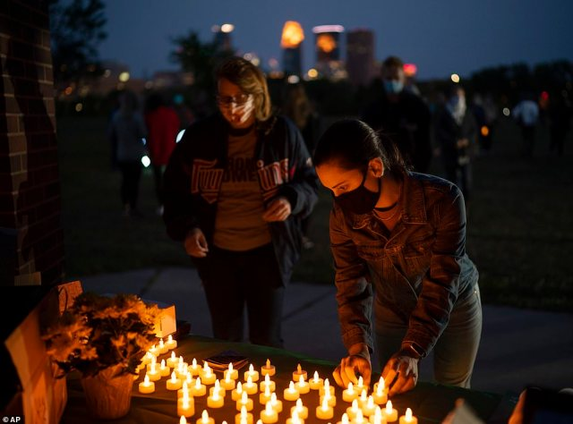 MINNEAPOLIS: People pick up electric candles at a vigil while Democrats - and some dissenting Republicans - blast Trump and McConnell as hypocritical and vow to take action to derail their plans to rush through a justice appointment