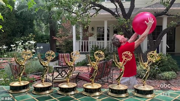 Emmy pose:Breaking Bad and Your Honor star Bryan Cranston broke out his six Emmy statuettes, as he recreated their pose with a beach ball