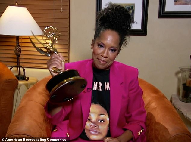 'Freaking weird': Regina King, who won lead actressfor her work in Watchmen, was seen sitting in an armchair wearing a T-shirt that honored police shooting victim Breonna Taylor
