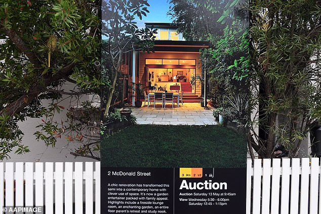 From this month, Australia's major banks are auditing 450,000 borrowers to determine if they can service their loans again, following six-month mortgage holidays.  Pictured is a Sydney house up for auction