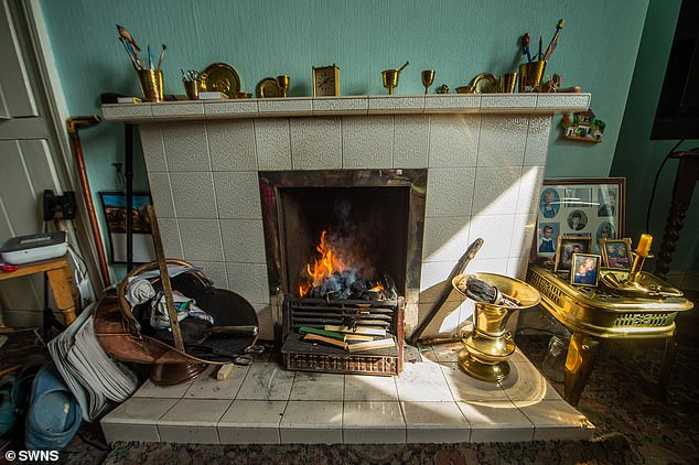 Back when Vera and her parents first moved into the property it had a coal fire (pictured) and an outside toilet