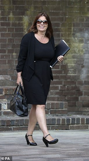 Donna-Maria Thomas, arriving at Portsmouth Crown Court today, is accused of trying to sneak into password-protected email accounts of staff more than 100 times after getting upset that she was asked to cancel a holiday