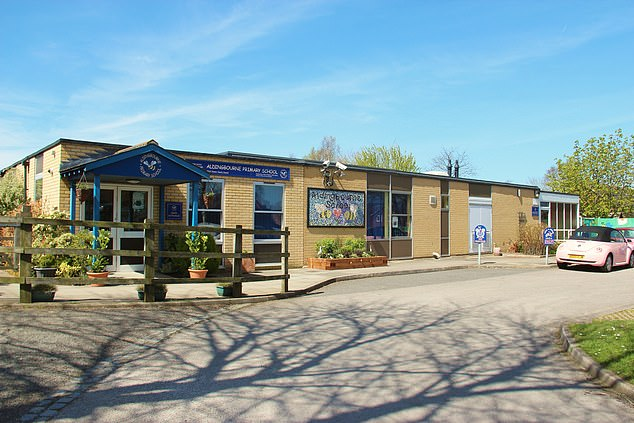 The 45-year-old illegally accessed computers at Aldingbourne Primary School, Chichester, (pictured) West Sussex, and scoured accounts containing 'highly confidential' material while looking for information 'she could use', it is alleged