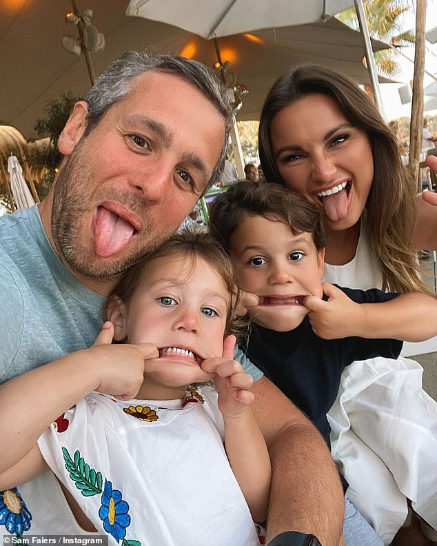Happy: Sam said she's finally happy with her skin after finding the perfect treatment (pictured with partner Paul Knightley and their children Paul Jnr, four, and Rosie, two)