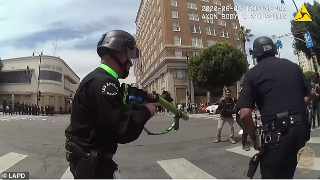 Montemayor (obscured right, behind the officer's arm) has since announced he will sue the LAPD, which the department has launched its own investigation