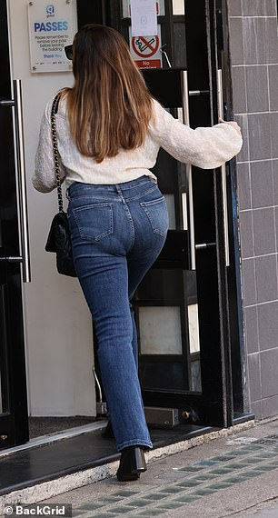 Jovial: Sheheaded into the studio in London to present the mid-afternoon show