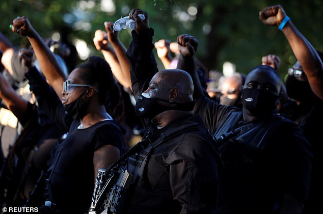 Members of black militia group NFAC protest in Louisville Kentucky on September 5. Perceived racial grievances over police killings have led to racial unrest