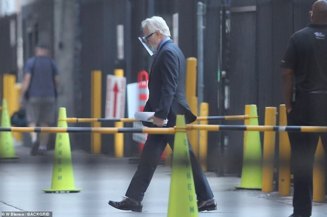 Power walk:Bradley Whitford, 60, is seen charging towards the set of the show