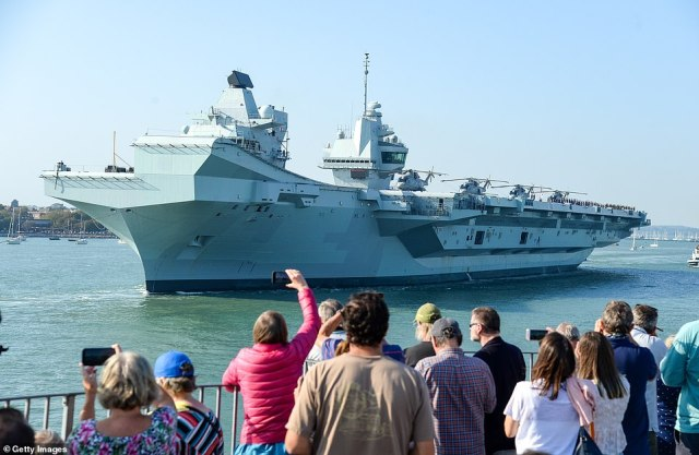 The Royal Navy's new £3.1 billion aircraft carrier HMS Queen Elizabeth finally set sail form Portsmouth today to join a dozen US and UK F-35B stealth fighters for drills in the North Sea