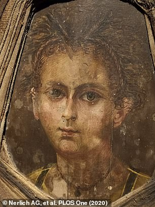 Pictured is the 'mummy portrait' that lays over the boy's embalmed face in the casket