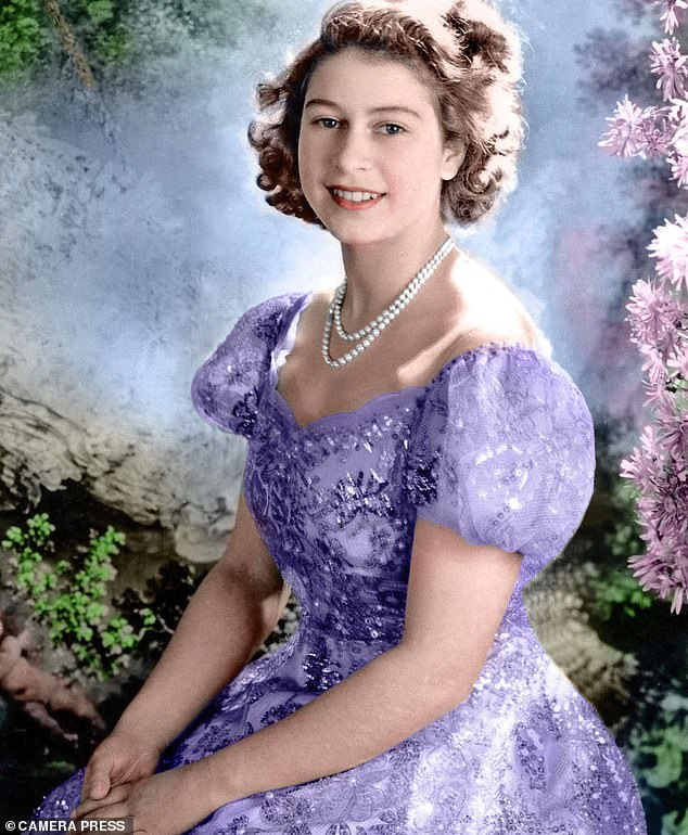 Rising confidence: A young Queen Elizabeth wearing one of her mother's gowns in 1945 at the age of 19