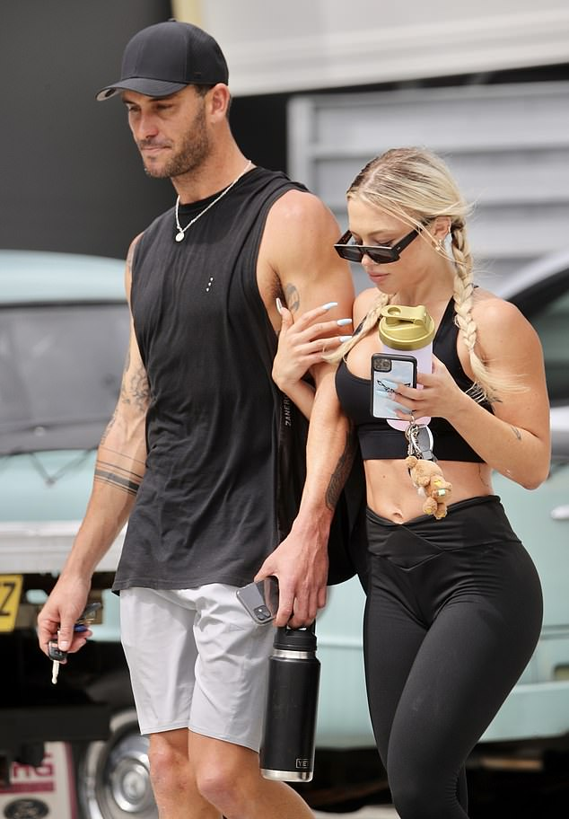 Hanging onto her man! Tammy Hembrow and new boyfriend Matt Poole packed on the PDA as they headed to the gym in the Gold Coast on Tuesday