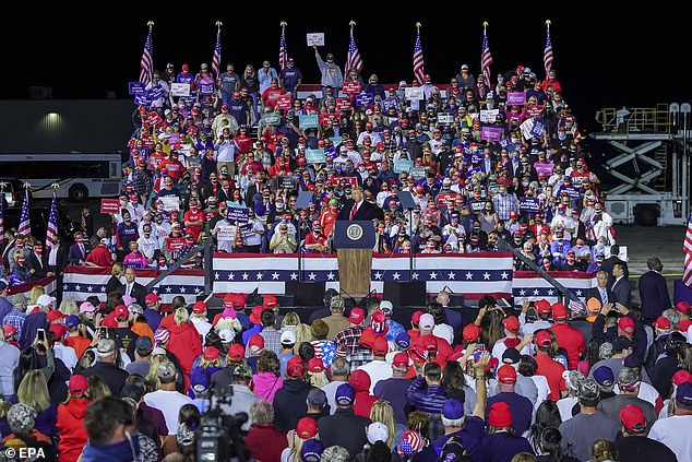 Surrounded by flag-waving supporters, the president warned of a threat to suburbia