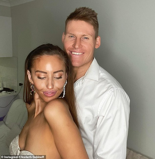 Tan the flames! The Married At First Sight star wore a glittering bustier top which highlighted her bronzed complexion as she cosied up to her other half