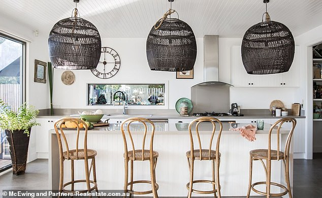 The house was built by the previous owners, a builder and stylist, who included an indoor fireplace, gas stove and waterfall kitchen bench in the two-storey property