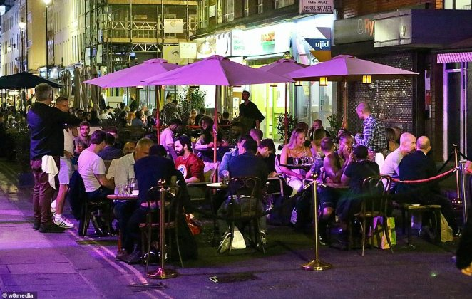 Soho was bustling last night as drinkers went to pubs and restaurants before the Government ushers in a 10pm curfew