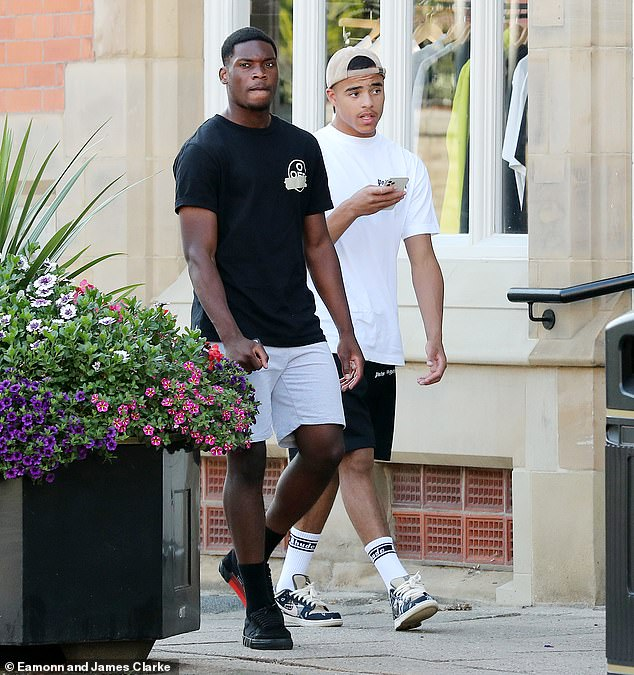 Make way:The striker looked relaxed in a white T-shirt and black shorts while shopping in Alderley Edge