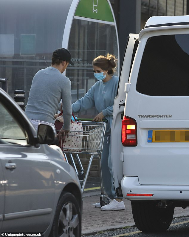 Couple:Stacey put safety first for the outing as she wore a face mask while taking her shopping to the van