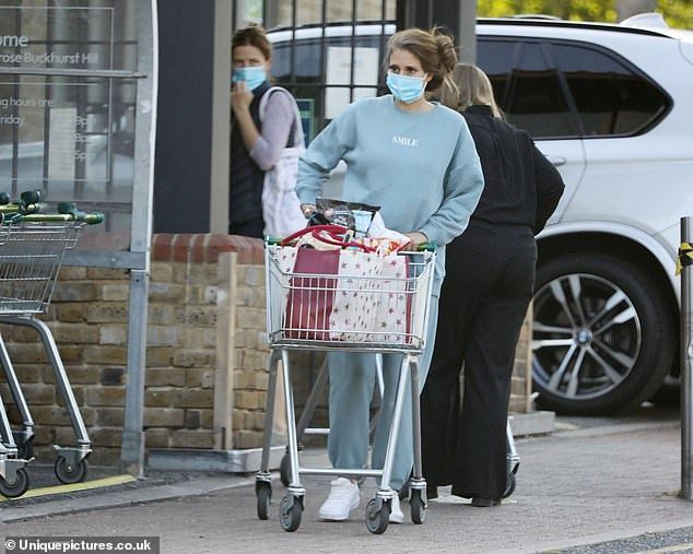 Casual:Stacey opted for a laid back look for the outing, donning a baby blue jumper with a 'Smile' print and matching tracksuit bottoms