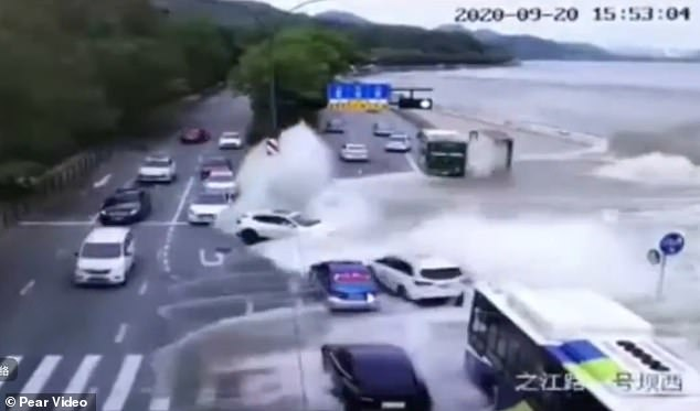 Viral footage shows the massive tidal wave rushing onto the busy road near the Qiantang River in eastern Chinese city Hangzhou on Sunday, swallowing a queue of cars within seconds