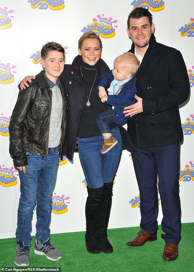 Her family: In a new interview, the singer, 38, who found fame in Hear'Say in 2000, also revealed that she wants another baby but worries about postnatal depression (pictured with fiancé Sam Greenfield and sons Corey and Rafferty, now 15 and four, in 2017)