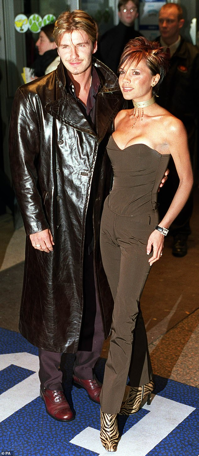Woah! David is seen in 2000 in a somewhat questionable leather mac