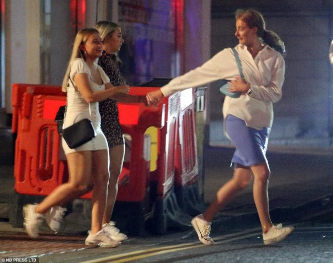 People cross a street in Leeds as scores of revellers hit the streets of the city to enjoy a night out amid the coronavirus pandemic