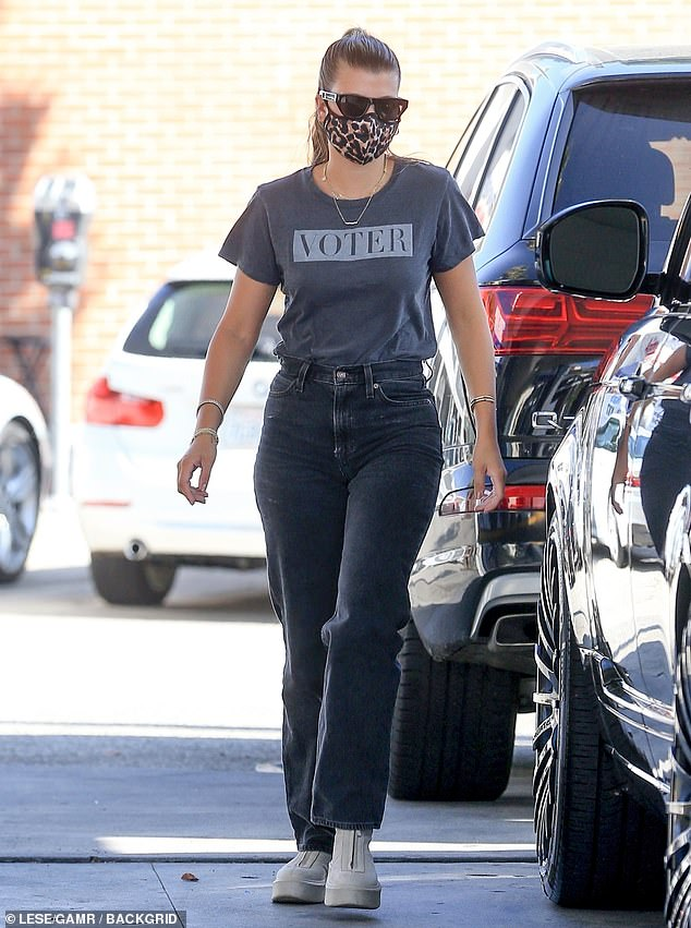 Civically engaged: Sofia Richie, 22, was spotted in a charcoal 'Voter' T-shirt on Tuesday as she filled up her SUV at a gas station in Los Angeles