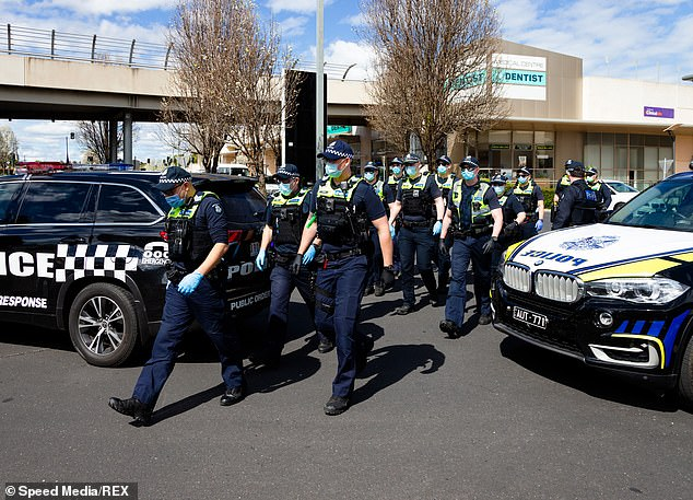 Victoria's state of emergency and disaster powers already give police the power to detain someone 'for the period reasonably necessary to eliminate or reduce a serious risk to public health'.Pictured: Police at a protest in Melbourne on Sunday
