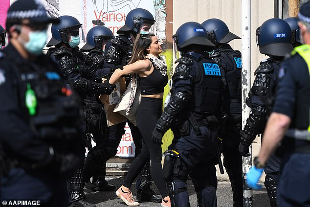 Innocent Victorians could be arrested in the street or at work by power-crazed officials under a new law Daniel Andrews wants to pass, top lawyers have warned. Pictured: A lockdown protester being arrested on Sunday in Melbourne