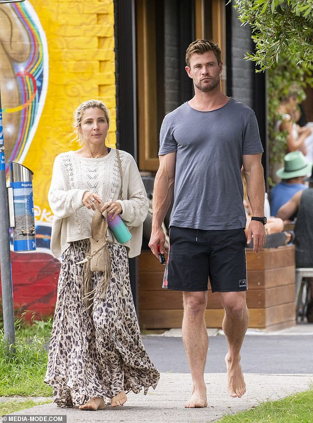 The natural look! Elsa Pataky (left) and her husband Chris Hemsworth (right) were spotted eating out in Byron Bay on Wednesday, going completely barefoot for the occasion