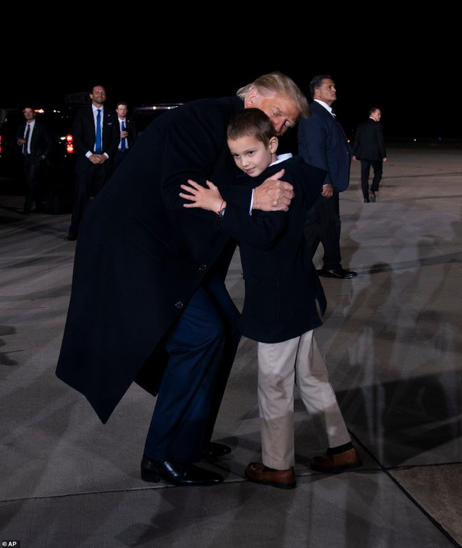 The Commander-in-chief also gave a hug to his six-year-old grandson Joseph as he made his way to Air Force One