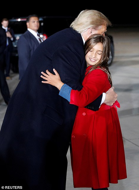 The President shared a sweet moment with two of his grandchildren on Tuesday evening