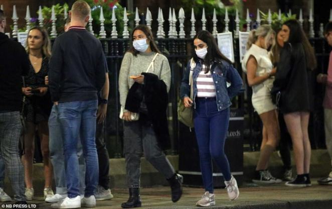 In Leeds some students tried to wear masks as they passed through revellers on the streets, but most were out socialising