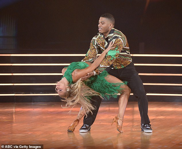 Grammy winner:Grammy-winning rapper Nelly, 45, and his partner Daniella Karagach, 28, turned in a jubilant cha cha to Earth, Wind & Fire's Let's Groove