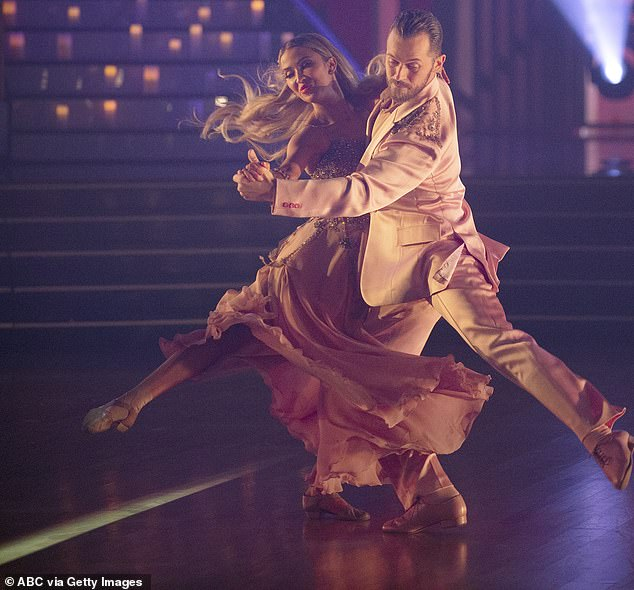 Injured dancer:Reality star Kaitlyn Bristowe, 35, tied for first with Artem Chigvintsev, 38, earning 42 points total, and 22 for their foxtrot to Lee Ann Womack's I Hope You Dance