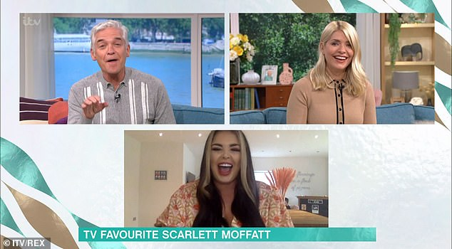 Giggles:Yet chat soon turned to Scarlett's boyfriend Scott Dobinson, who appeared in the background carrying her pet dog Bonny