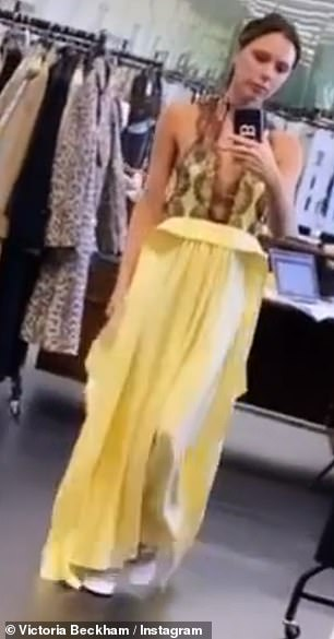 Which?  The fashion designer, 46, took to Instagram to ask fans if she should wear the yellow or purple version of the maxi dress