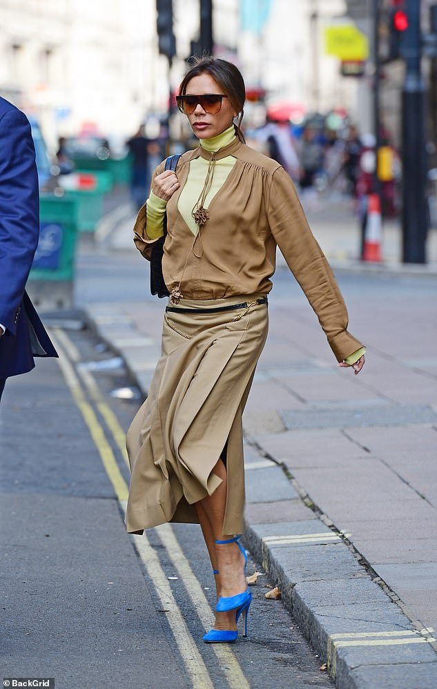 Fashionista: She accessorized her look with her oversized undertones and blue suede stiletto heels