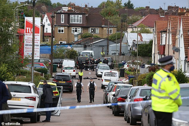 The road by the industrial estate in Barnet was closed off while officers investigated the situation