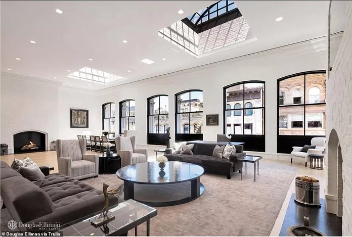 This three-story loft in Manhattan's SoHo sold for $35.14million, marking a record real-estate deal for the neighborhood. The loft covers almost 8,000 square ft and includes a living room with two wood-burning fireplaces, pictured above
